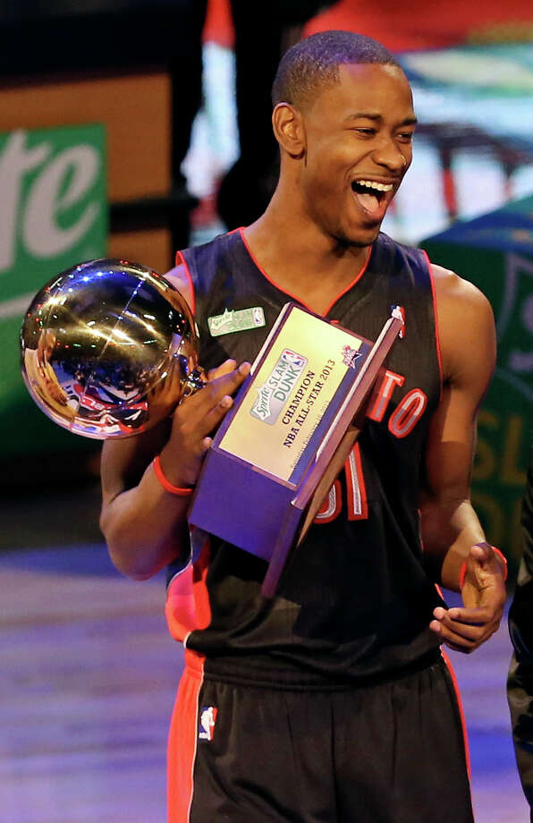 Toronto Raptors' Terrence Ross is all smiles after winning the Sprite Slam Dunk Contest at the Toyota Center Saturday, Feb. 16, 2013, in Houston. Photo: Edward A. Ornelas, San Antonio Express-News / © 2013 San Antonio Express-News