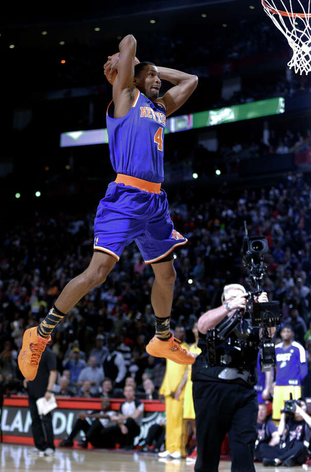 James White of the New York Knicks heads to the basket during the dunk contest at NBA basketball All-Star Saturday Night, Feb. 16, 2013, in Houston. Photo: Eric Gay, Associated Press / AP