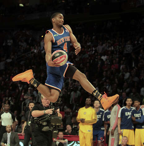 James White of the New York Knicks  competes in the NBA All-Star Slam Dunk Contest at the Toyota Center on All-Star Saturday Night, Saturday, Feb. 16, 2013, in Houston. Photo: James Nielsen, Houston Chronicle / © 2013  Houston Chronicle