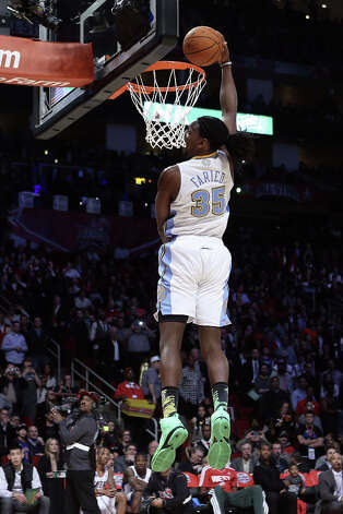 Kenneth Faried of the Denver Nuggets dunks the ball in the first round during the Sprite Slam Dunk Contest part of 2013 NBA All-Star Weekend at the Toyota Center on February 16, 2013 in Houston. Photo: Ronald Martinez, Getty Images / 2013 Getty Images