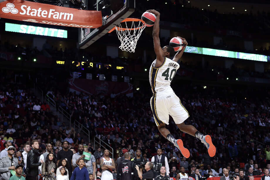 Jeremy Evans of the Utah Jazz dunks two basketballs in the second round during the Sprite Slam Dunk Contest part of 2013 NBA All-Star Weekend at the Toyota Center on February 16, 2013 in Houston. Photo: Ronald Martinez, Getty Images / 2013 Getty Images