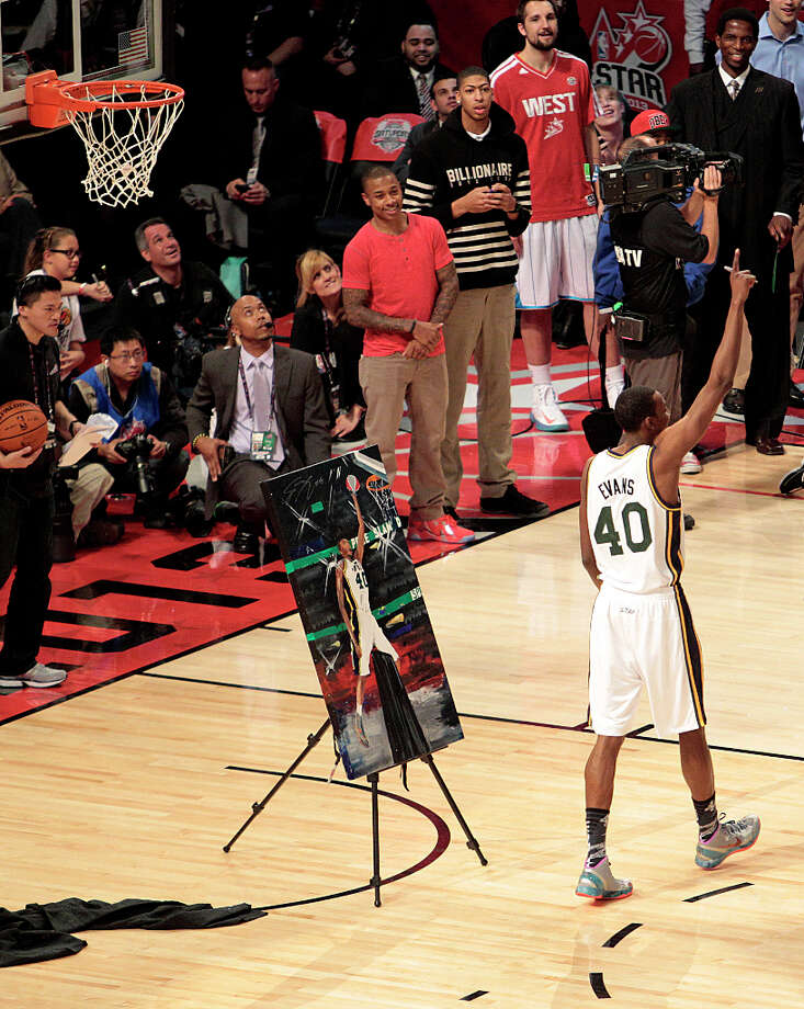 Jeremy Evans of the Utah Jazz  signs an image of  himself after completing a dunk as he competes in the NBA All-Star Slam Dunk Contest at the Toyota Center on Saturday, Feb. 16, 2013, in Houston. Photo: Billy Smith II, Houston Chronicle / © 2013 Houston Chronicle