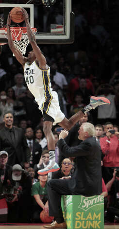 Jeremy Evans of the Utah Jazz dunks over former Jazz player Mark Eaton during the NBA All-Star Slam Dunk Contest at the Toyota Center on All-Star Saturday Night, Saturday, Feb. 16, 2013, in Houston. Photo: James Nielsen, Houston Chronicle / © 2013  Houston Chronicle