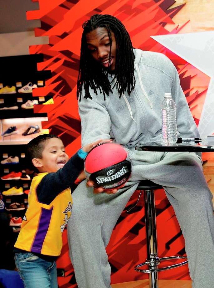 Kenneth Faried of the Denver Nuggets and Harrison Barnes of the Golden State Warriors meet fans at the Adidas Store at Galleria Mall during NBA All-Star in Houston. (Photo by Noah Graham/NBAE via Getty Images)