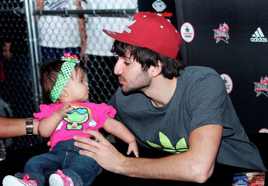 Ricky Rubio of the Minnesota Timberwolves meets a young fan during an appearance at Foot Locker Feb. 16 at the Galleria Mall during NBA All-Star.