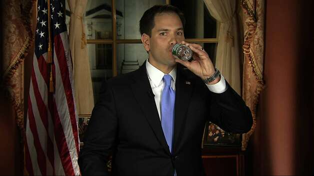 The sip heard around the world: In this frame grab from video, Florida Sen. Marco Rubio takes a sip of water during his Republican response to President Barack Obama's State of the Union address on Tuesday in Washington. The substance of the GOP's response was lost in the hubbub over Rubio's drink of water, which he blamed on God. Photo: AP