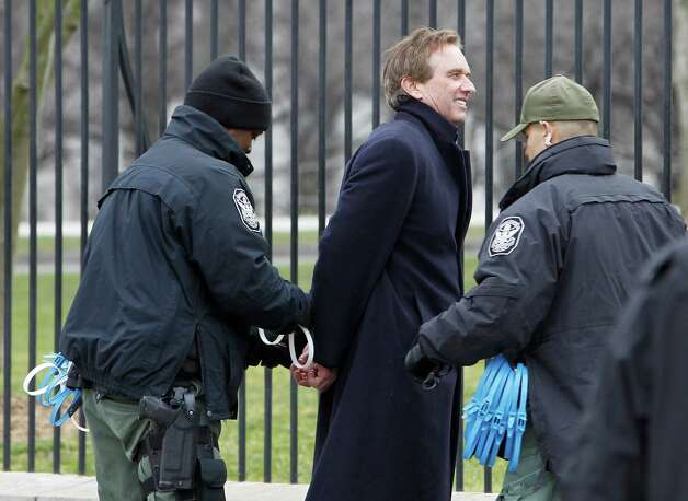 Robert F. Kennedy Jr. is arrested in Washington, Wednesday as prominent environmental leaders tied themselves to the White House gate to protest the Keystone XL oil pipeline. Photo: AP