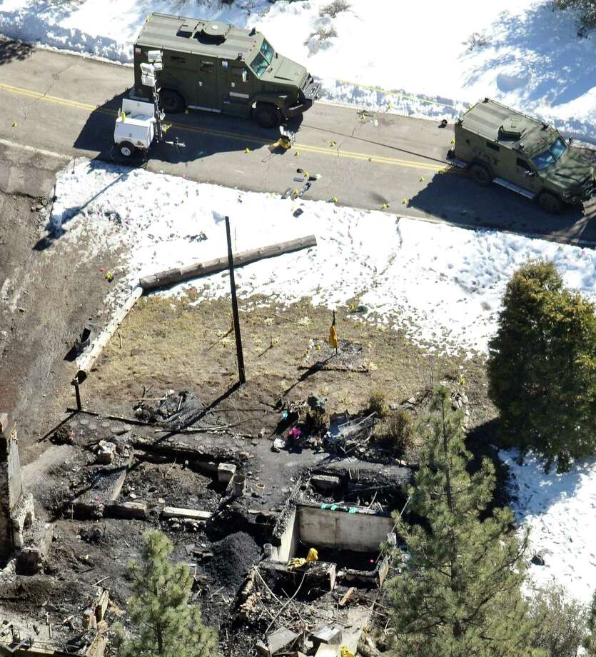 In this aerial photo, law enforcement authorities investigate the charred remnants of a cabin Wednesday in the Angeles Oaks area of Big Bear, Calif. An official briefed on the investigation tells The Associated Press that a wallet with a California driver's license with the name Christopher Dorner has been found in the rubble of a cabin. A charred body was also found inside after a shootout and fire. Authorities believe the remains are those of the former Los Angeles police officer, but they have not been formally identified. Photo: AP