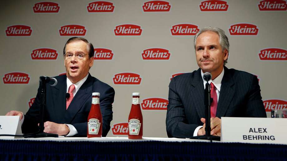 H.J. Heinz Co. CEO William Johnson, left, and 3G Capital Managing Partner Alex Behring speak at a news conference at the world headquarters of the H.J. Heinz Co. on Thursday in Pittsburgh. Billionaire investor Warren Buffett's Berkshire Hathaway and its partner on the deal. 3G Capital, are dipping into the ketchup business as part of a $23.3 billion deal to buy the Heinz ketchup company. Photo: AP