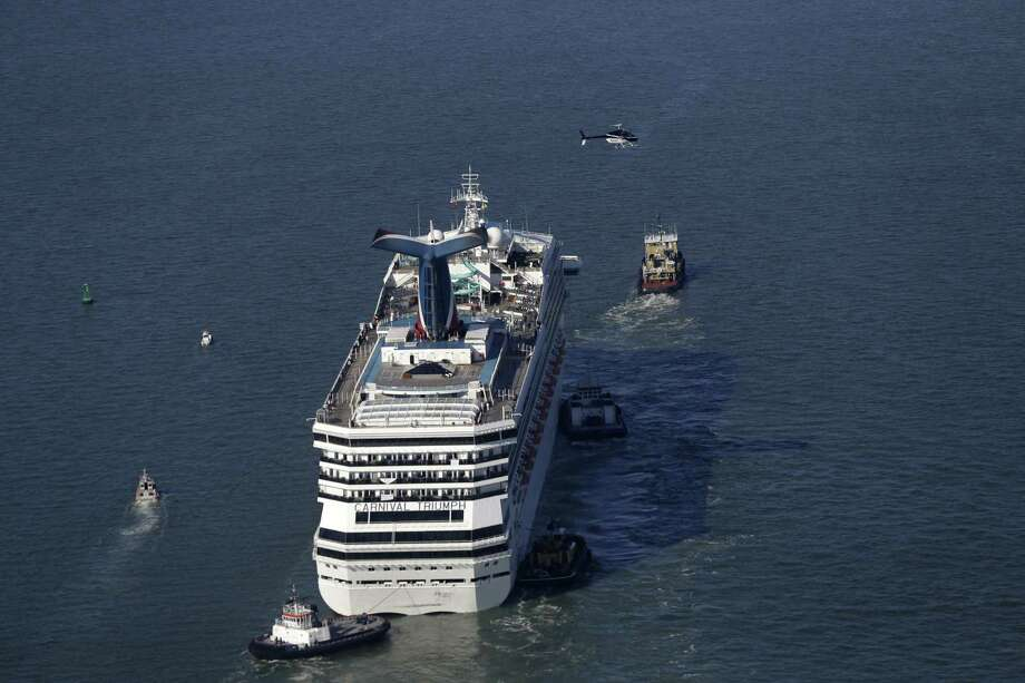 The disabled Carnival Lines cruise ship Triumph is towed to harbor off Mobile Bay, Ala., Thursday. Photo: Gerald Herbert, AP / AP