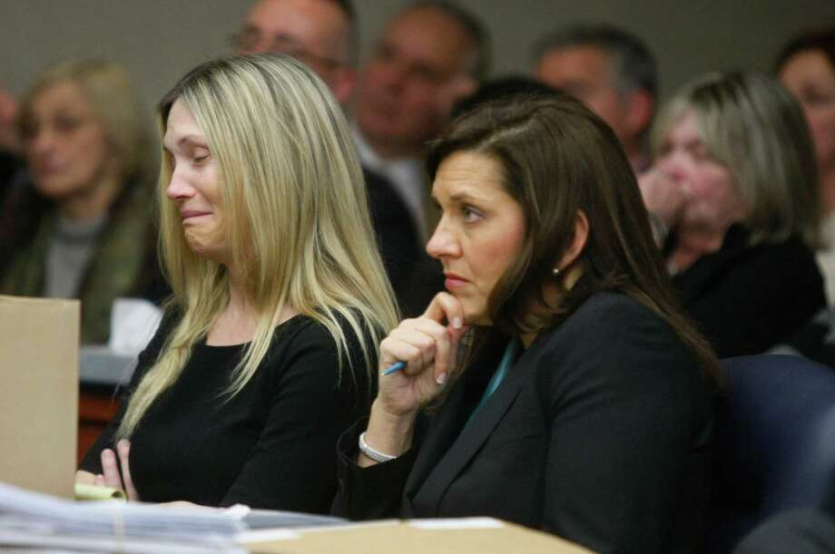 """Amy Locane Bovenizer cries as she is being sentenced on Thursday in Somerville, N.J.   Locane-Bovenizer, the former """"Melrose Place"""" actress who was driving drunk when her SUV plowed into a car and killed a New Jersey woman has been sentenced to three years in prison. Locane-Bovenizer faced up to 10 years in prison after a jury in November convicted her of vehicular homicide in the 2010 death of 60-year-old Helene Seeman in Montgomery Township. The judge lowered the maximum sentence citing the hardship on Locane-Bovenizer's two children. One has a medical and mental disability.  Locane-Bovenizer's blood-alcohol level was nearly three times the legal limit when the crash occurred. Photo: AP"""
