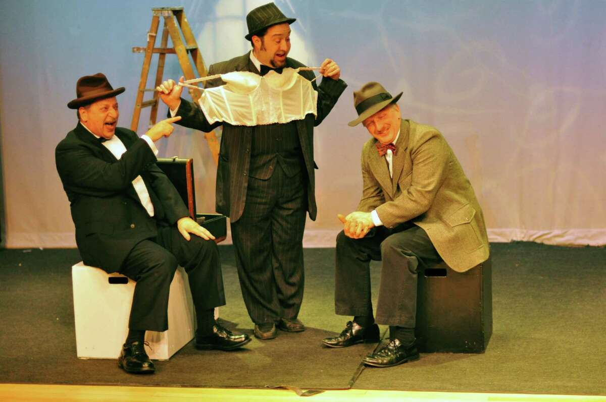 Actors P.J. Morello, Vic Terenzio and David Victor rehearse a scene on a train with an underwear salesman for the upcoming production of