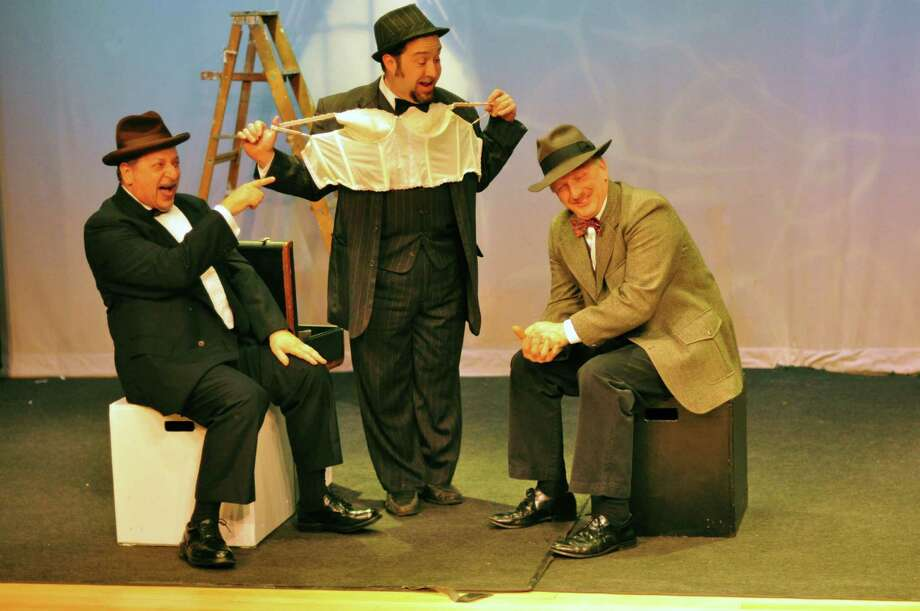 "Actors  P.J. Morello, Vic Terenzio and David Victor rehearse a scene on a train with an underwear salesman for the upcoming production of ""The 39 Steps"" at the Darien Arts Center Stage. Photo: Contributed"