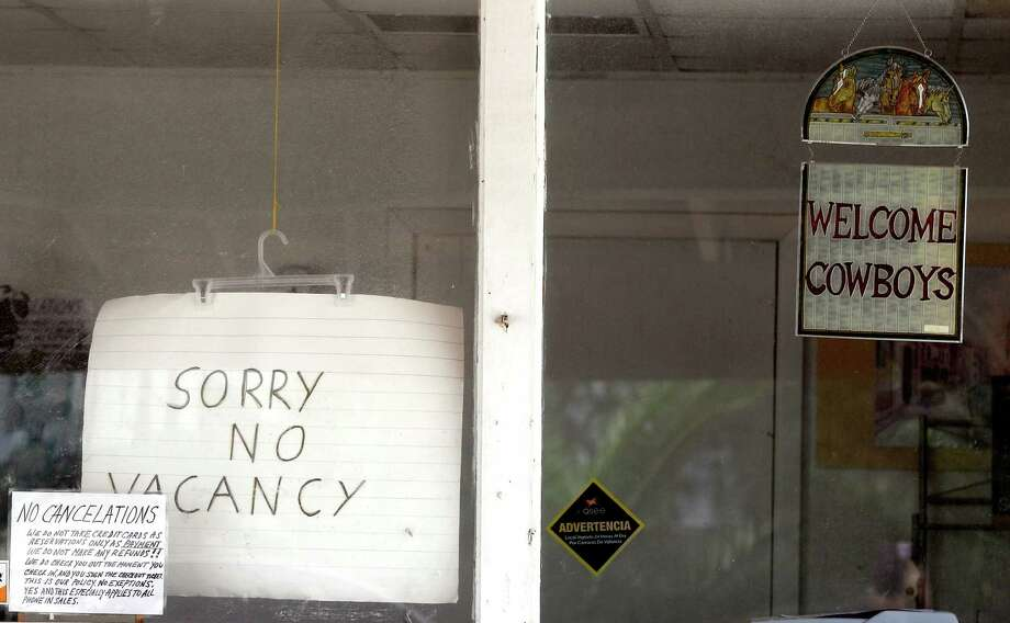 A no vacancy sign is seen in the window of a motel, May 9, 2012, in Kennedy, Texas. A UTSA report says South Texas's Eagle Ford Shale oil and gas bonanza supported nearly 48,000 jobs last year while creating overnight boom towns cashing in on a $25 billion economic windfall. The energy rush that started in 2008 mushroomed into nearly 1,700 wells last year. (AP Photo/Eric Gay) Photo: Eric Gay, Associated Press / AP