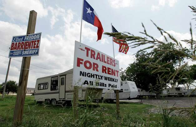 Because housing is in high demand, travel trailers are up for rent in Kenedy, Texas, Wednesday, May 9, 2012. A UTSA report says South Texas's Eagle Ford Shale oil and gas bonanza supported nearly 48,000 jobs last year while creating overnight boom towns cashing in on a $25 billion economic windfall. The energy rush that started in 2008 mushroomed into nearly 1,700 wells last year.(AP Photo/Eric Gay) Photo: Eric Gay, Associated Press / AP
