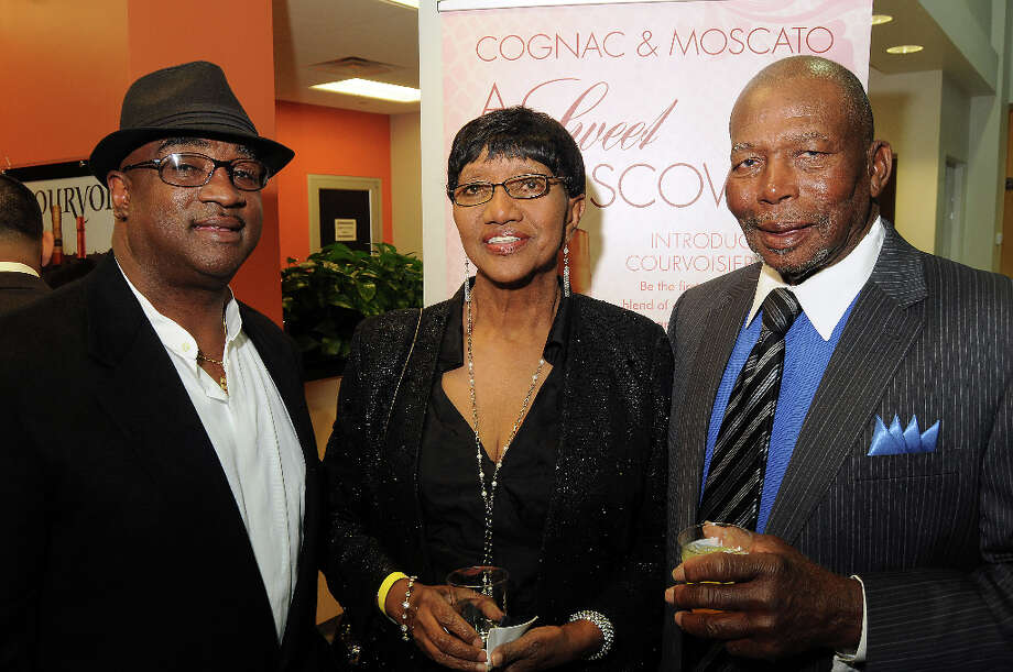 From left: Weldon Meeks wit Ann and W.C. Curtis at a party hosted by the NBRPA Houston at the Mercedes Benz of Houston dealership Saturday Feb. 16, 2013. Photo: Dave Rossman, For The Houston Chronicle / © 2013 Dave Rossman