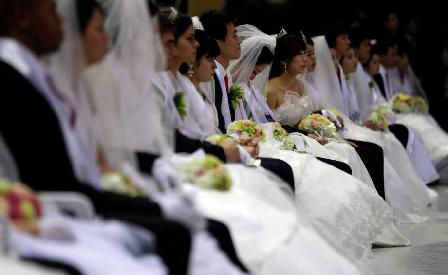 Couples from around the world participate in a mass wedding ceremony at the CheongShim Peace World Center in Gapyeong, South Korea, Sunday. Photo: AP