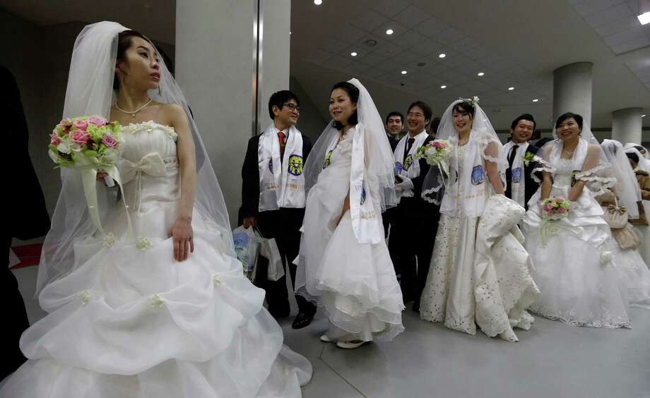 Couples from around the world arrive for their mass wedding ceremony at the CheongShim Peace World Center in Gapyeong, South Korea, Sunday. Photo: AP