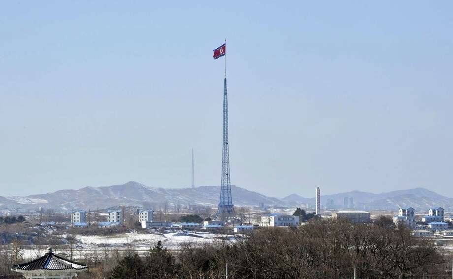 A giant North Korean flag flutters on the top of a tower in the propaganda village of Gijeongdong, North Korea, as it is seen from South Korea's Taesungdong freedom village near the border village of Panmunjom on Friday. Photo: AP
