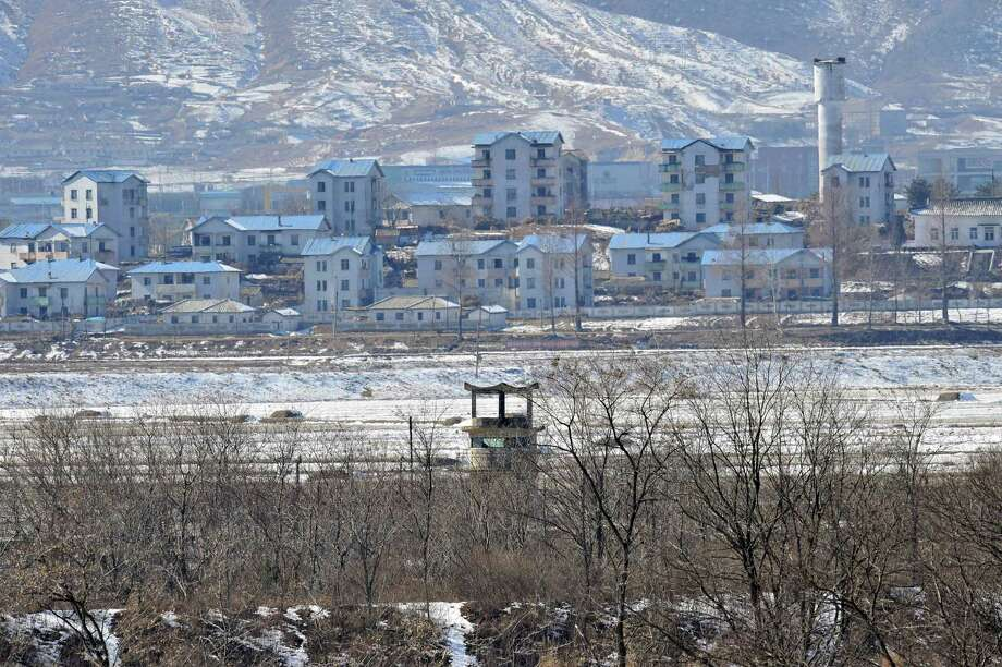A North Korean guard post, center, in the propaganda village of Gijeongdong, North Korea, is seen from South Korea's Taesungdong freedom village near the border village of Panmunjom on Friday. Photo: AP