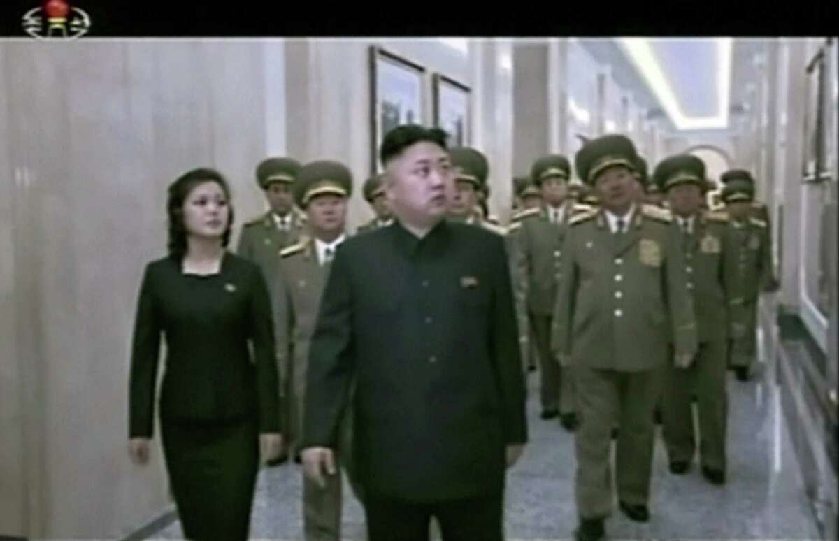 In this image made from video take Saturday, North Korean leader Kim Jong Un, center, and his wife Ri Sol Ju tour as they visit the Kumsusan Palace of the Sun in Pyongyang, North Korea to pay respect to late North Korean leader Kim Jong Il on his birth anniversary. (AP Photo/KRT via AP Video)