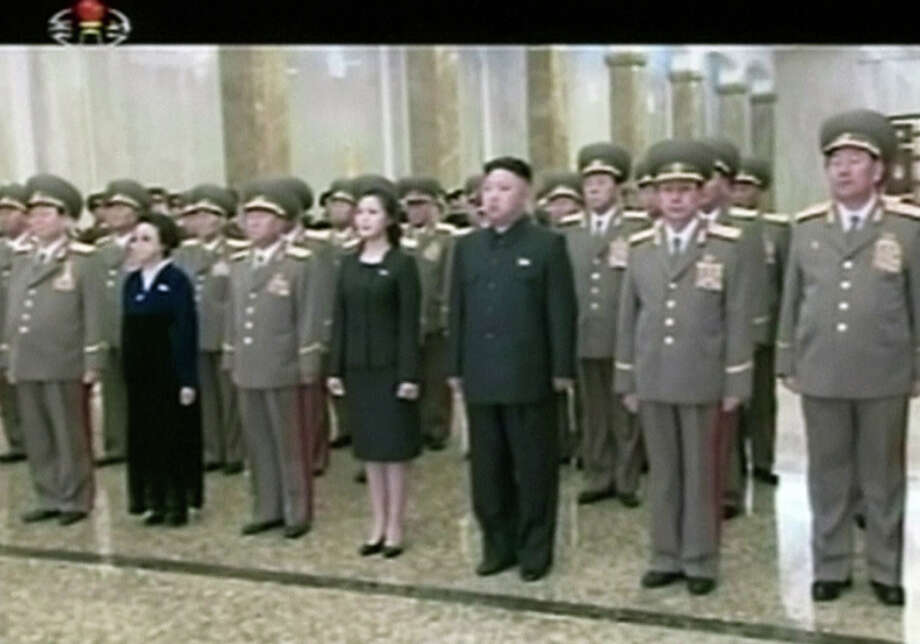 In this image made from video on Saturday, North Korean leader Kim Jong Un, center right, and his wife Ri Sol Ju, center left, arrive at the Kumsusan Palace of the Sun in Pyongyang, North Korea to pay respect to late North Korean leader Kim Jong Il on his birth anniversary. (AP Photo/KRT via AP Video)  Photo: AP