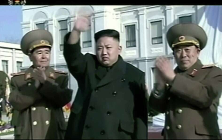 In this Feb. 16, 2013 image made from video, North Korean leader Kim Jong Un, center, waves as he at