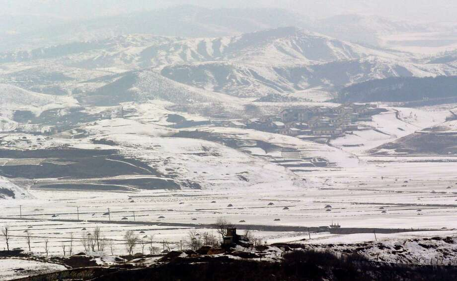 A North Korean military guard post, center bottom, in North Korea's Kaepoong is viewed from the unification observation post near the border village of Panmunjom, that has separated the two Koreas since the Korean War, in Paju, north of Seoul, South Korea, Wednesday. Photo: AP