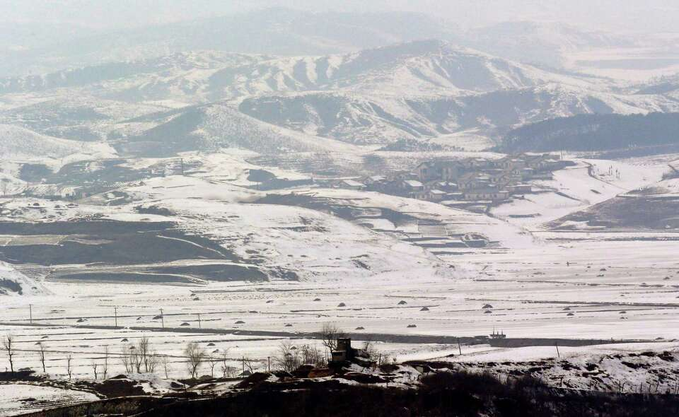 A North Korean military guard post, center bottom, in North Korea's Kaepoong is viewed from the unif