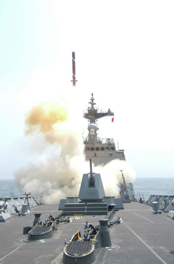 In this undated photo released by the South Korean Defense Ministry on Thursday a South Korean ship-to-land cruise missile is fired from a destroyer during a drill at an undisclosed location in South Korea.  Photo: AP