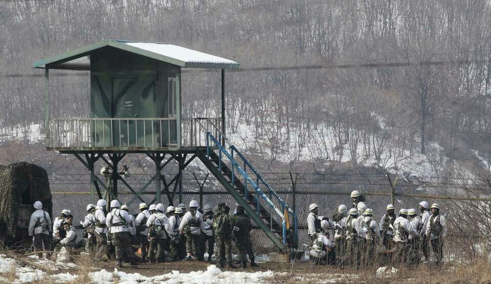 South Korean army soldiers gather as they attend an exercise near the demilitarized zone of Panmunjo
