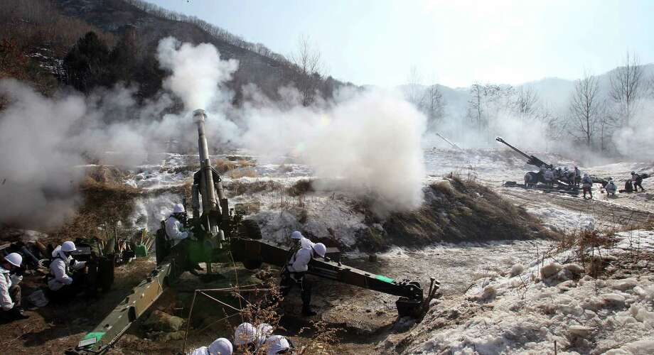 A South Korean Army's 155 mm howitzer fires live rounds during an exercise at Fire Training Field in Cheorwon, South Korea, Friday. (AP Photo/Lee Sang-hack, Yonhap) Photo: AP