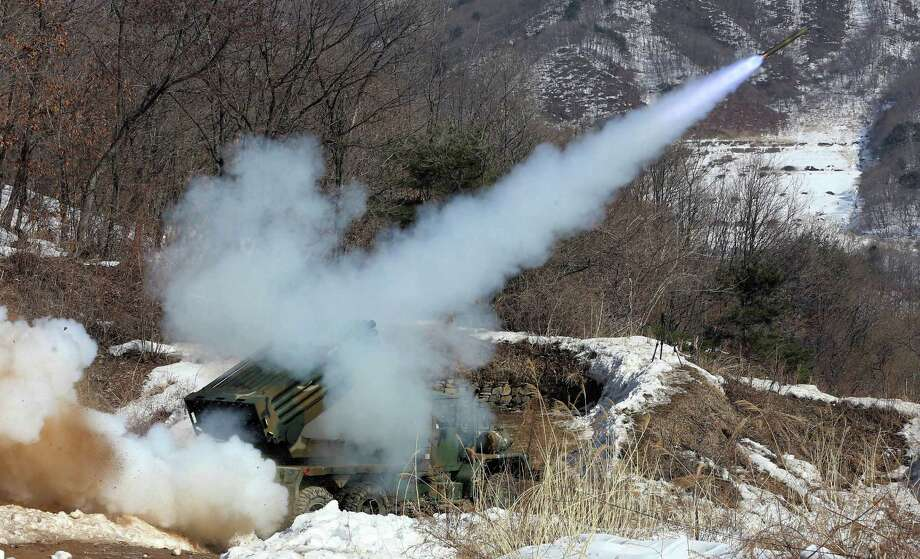 South Korean Army's Multiple rocket launcher fires live rounds during an exercise at Fire Training Field in Cheorwon, South Korea, Friday. (AP Photo/Lee Sang-hack, Yonhap) Photo: AP