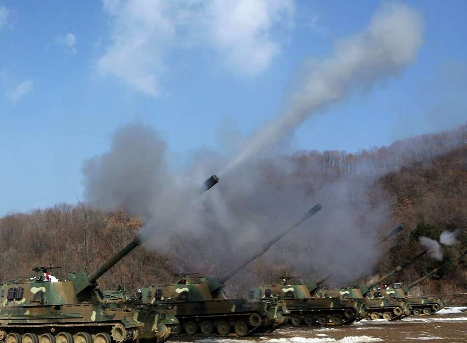 South Korean army K-9 self-propelled guns fire live rounds during an exercise at Fire Training Field in Cheorwon, South Korea, Friday. (AP Photo/Lee Sang-hack, Yonhap) Photo: AP