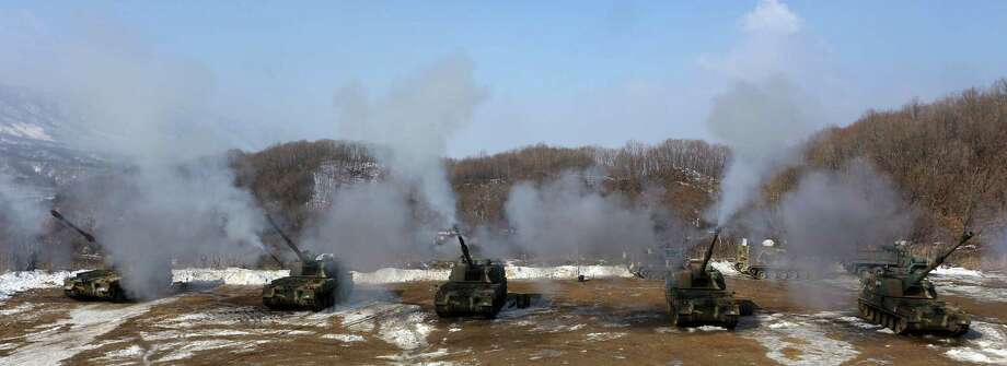 South Korean army K-9 self-propelled guns fire live rounds during an exercise at Fire Training Field in Cheorwon, South Korea, Friday. North Korea is upgrading one of its two major missile launch sites, apparently to handle much bigger rockets, and some design features suggest it is getting help from Iran, a U.S. research institute said Thursday. (AP Photo/Lee Sang-hack, Yonhap)  Photo: AP