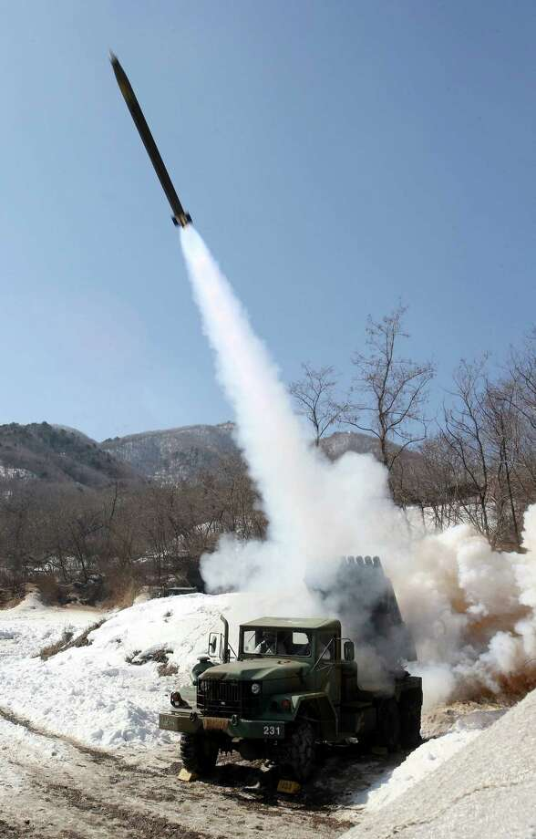 South Korean Army's multiple rocket launcher fires live rounds during an exercise at Fire Training Field in Cheorwon, South Korea, Friday. (AP Photo/Yonhap, Lee Sang-hack) Photo: AP