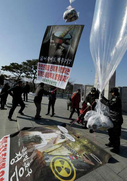 North Korean defectors and South Korean activists prepare to launch helium balloons carrying leaflet