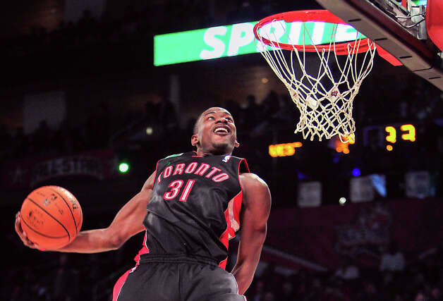 Slam Dunk contestWinner: Terrence Ross, Toronto RaptorsRoss goes between his legs for a dunk during Saturday's night contest. Photo: James Nielsen, Houston Chronicle / © 2013  Houston Chronicle