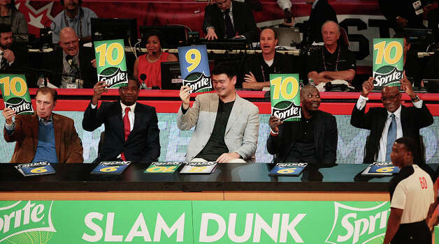 Houston Rocket legends Rudy Tomjanovich, Dikembe Mutombo, Yao Ming, Hakeem Olajuwon, and Clyde Drexler show their scores as judges of the NBA All-Star Slam Dunk Contest. Photo: Billy Smith II, Houston Chronicle / © 2013 Houston Chronicle