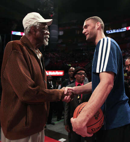 Brook Lopez of the Brooklyn Nets shakes hands with NBA legend Bill Russell before competing in the NBA All-Star Shooting Stars competition. Photo: James Nielsen, Houston Chronicle / © 2013  Houston Chronicle