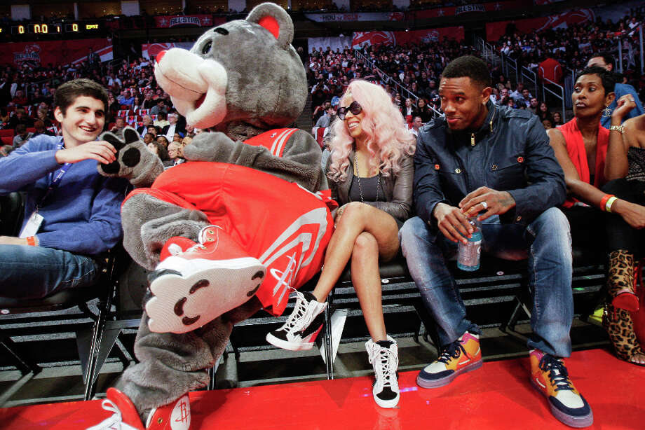 Cleveland Cavaliers guard Daniel Gibson, right, sits with Keysia Cole and Rockets mascot Clutch as they watch the NBA All-Star Shooting Stars competition. Gibson is from Houston, where he played at Jones High School before the University of Texas. Photo: Melissa Phillip, Houston Chronicle / © 2013  Houston Chronicle