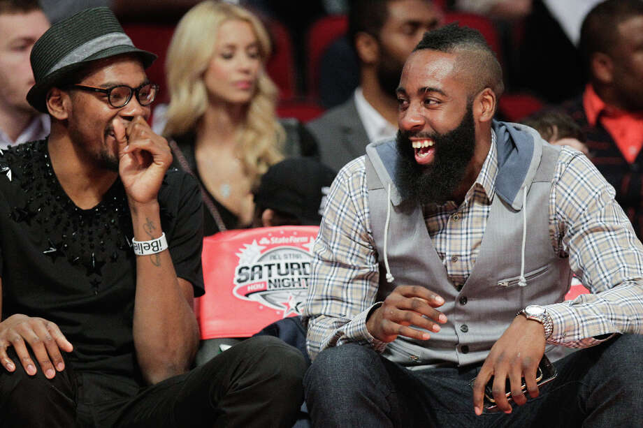 James Harden of the Houston Rockets, right, laughs with Kevin Durant of the Oklahoma City Thunder as they watch the NBA All-Star Skills Challenge. Photo: Melissa Phillip, Houston Chronicle / © 2013  Houston Chronicle