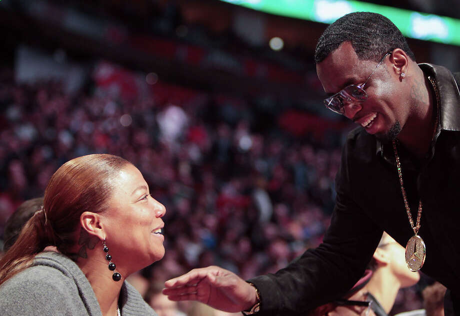Sean Combs laughs with Queen Latifah as they watch the NBA All-Star Slam Dunk Contest. Photo: James Nielsen, Houston Chronicle / © 2013  Houston Chronicle