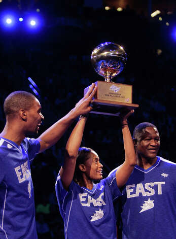 Chris Bosh of the Miami Heat, Swin Cash of the Chicago Sky and Dominique Wilkins celebrate with their trophy after winning the NBA All-Star Shooting Stars competition. Photo: Melissa Phillip, Houston Chronicle / © 2013  Houston Chronicle