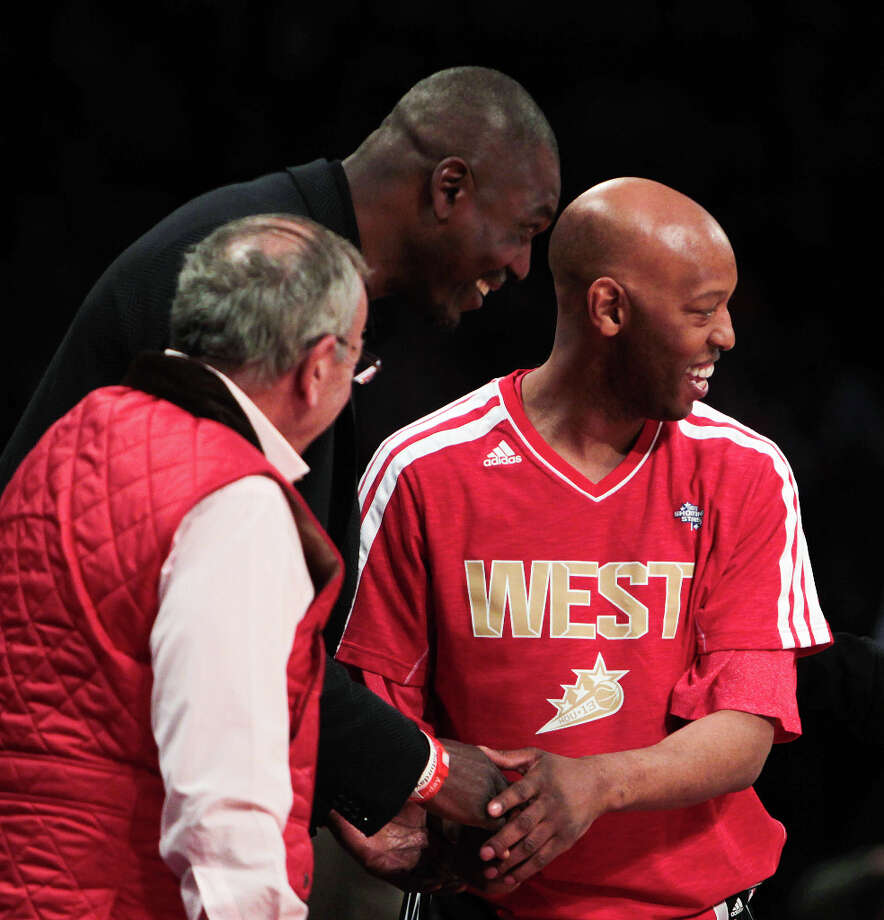 Sam Cassell greets Hakeem Olajuwon before competing in the NBA All-Star Shooting Stars competition. Photo: James Nielsen, Houston Chronicle / © 2013  Houston Chronicle