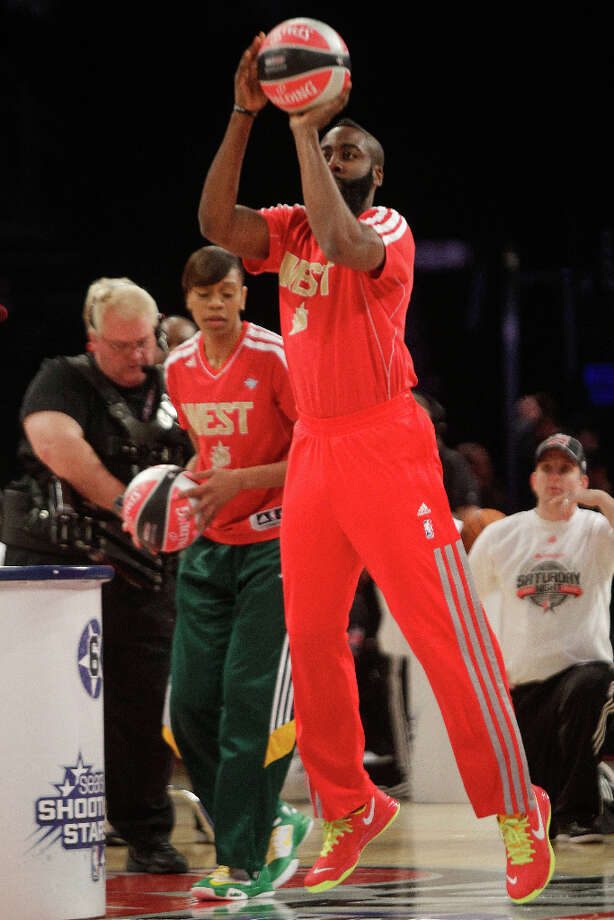 James Harden of the Houston Rockets takes a shot during the NBA All-Star Shooting Stars competition. Photo: Melissa Phillip, Houston Chronicle / © 2013  Houston Chronicle