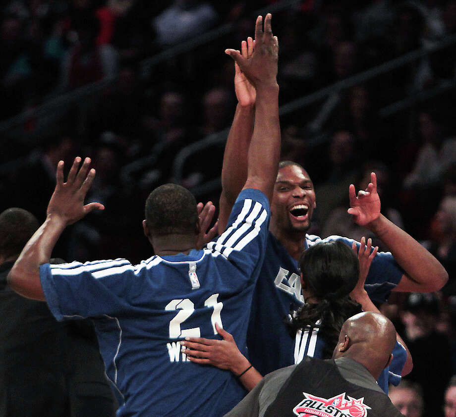 Chris Bosh of the Miami Heat, Swin Cash of the Chicago Sky  and Dominique Wilkins celebrate after winning the NBA All-Star Shooting Stars competition. Photo: James Nielsen, Houston Chronicle / © 2013  Houston Chronicle