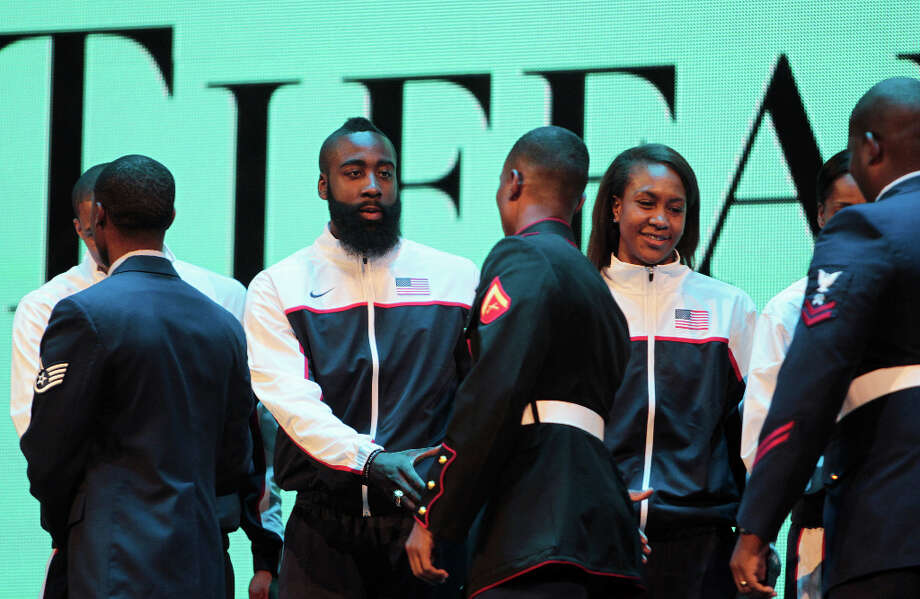 James Harden of the Houston Rockets  shakes hands with US service members during a presentation of Tiffany rings to the gold medal winning 2012 US Olympic Team. Photo: James Nielsen, Houston Chronicle / © 2013  Houston Chronicle