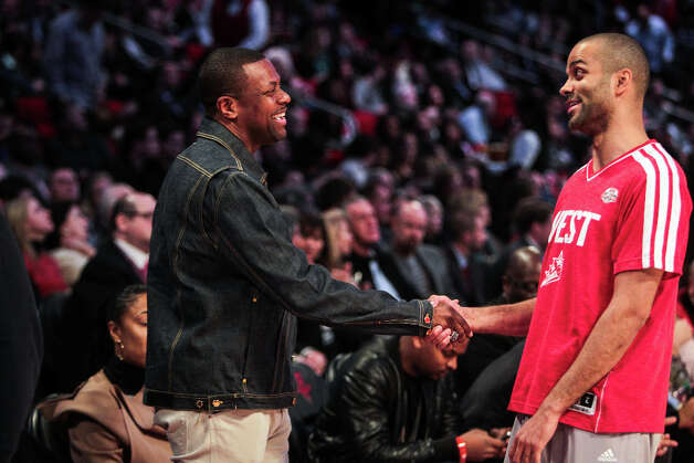 Actor and comedian Chris Tucker shakes hands with Tony Parker of the San Antonio Spurs before the NBA All-Star Skills Challenge. Photo: James Nielsen, Houston Chronicle / © 2013  Houston Chronicle