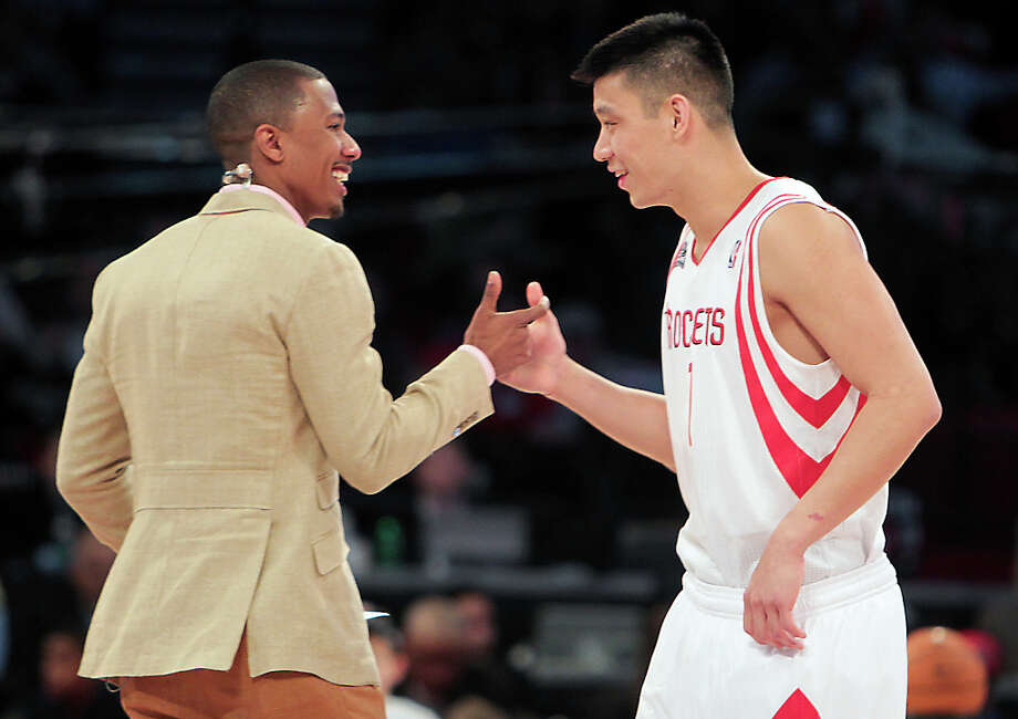 Jeremy Lin of the Houston Rockets greets master of ceremonies Nick Cannon before competing in the NBA All-Star Skills Challenge. Photo: James Nielsen, Houston Chronicle / © 2013  Houston Chronicle